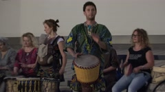 musicians group play african drum instruments in street music festival. 4K - stock footage