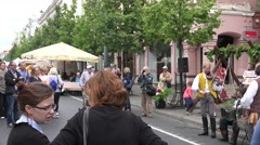 Panorama view of people listen country music band in city. 4K Arkistovideo