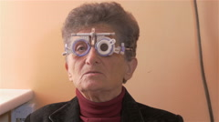 Older woman at ocular review checking diopter, face close up, no grading, 4K. Stock Footage