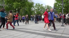 Active dancers people in pairs dance lindy hop in street. 4K Stock Footage