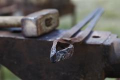 anvil , blacksmith tools close-up - stock photo