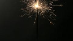 Burning sparkler on black background Stock Footage