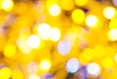 yellow and violet flickering Christmas lights - stock photo