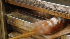 German baker pulls huge bread from the oven Stock Footage