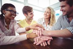 Stock Photo of Creative businessteam making a large motivation gesture