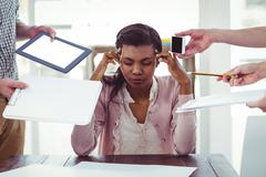 Businesswoman stressed out at work - stock photo