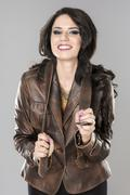 pretty attractive erotic woman in brown jacket - stock photo