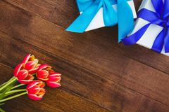 Stock Photo of View of red flowers and blue gifts