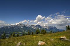 Stock Photo of View from Brandstadl towards Wilder Kaiser cloudy sky Scheffau am Wilden Kaiser