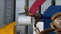 Hoist lifts coil of production material Stock Footage