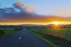 country road to Unza at sunset - stock photo