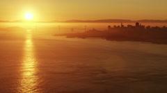 Aerial sunrise view Golden Gate Bridge San Francisco city Pacific America Stock Footage