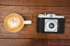 View of an old camera with coffee - stock photo