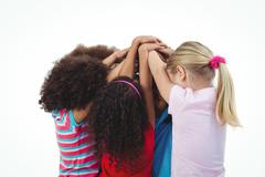 Stock Photo of Small group of girls huddled together