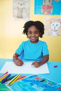 School kid drawing on a sheet Stock Photos