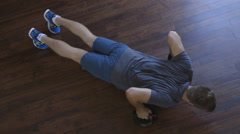 Stock Video Footage of Ariel view of a young man doing Press ups at home