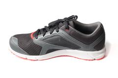 Stock Photo of New unbranded running shoe color black and red, sneaker or trainer isolated