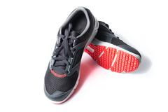 New unbranded running shoe color black and red, sneaker or trainer isolated  - stock photo