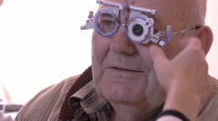 Determining diopter on eyes of older man, face extreme close up, raw video, 4K. - stock footage