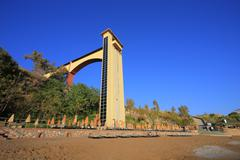Beach and footbridge with lift - stock photo