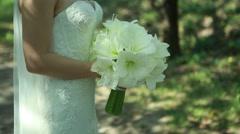 Beautiful wedding bouquet in hands - stock footage