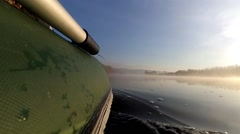 Boat moving forward in Sunrise on misty river Stock Footage