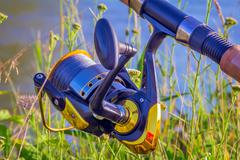 Feeder - English fishing tackle for catching fish. Stock Photos