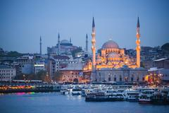 New Mosque (Yeni Cami) at night with Hagia Sophia (Aya Sofya) behind seen across Stock Photos