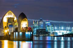 Thames Barrier, Millennium Dome (O2 Arena) and Canary Wharf at night, London, Stock Photos