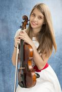 Teenage girl with viola - stock photo