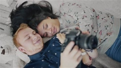 Happy couple looking photos and smiling (Slow Motion) Stock Footage
