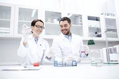 Young scientists making test or research in lab Kuvituskuvat