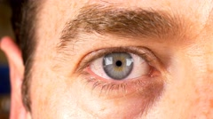 Man  eye close up blue male scared angry emotions iris contracting 4k Stock Footage