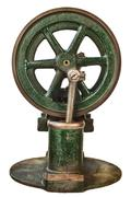 Wheel of an old steam engine - stock photo