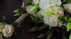 bridal bouquet and wedding rings on the table - stock footage