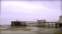 Pier at Low Tide. Tilt Shift Timelapse Stock Footage
