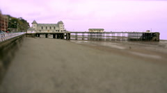 Pier, Promenade and Beach at Low Tide. Tilt Shift Timelapse Stock Footage