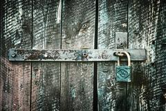 Locked wooden doors close up, retro style - stock photo