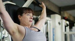 4K Professional female weightlifter training with weights at the gym Stock Footage