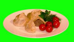 4k – Halves of manti (dumplings) with vegetables on plate Stock Footage