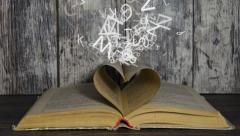 Concept of love for book. Letters flying out of book Stock Footage
