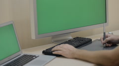 Screen For Mock Up Designing at Wood Desk at computer and Modern devices Dual Stock Footage