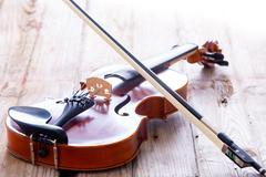 Close up Small Violin for Kids on the Floor - stock photo