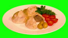 4k – Halves of manti (dumplings) and cherry tomatoes on plate Stock Footage