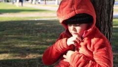 Portrait of a congealed little boy Stock Footage