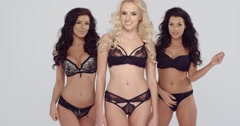 Three shapely fashion models in black lingerie - stock footage