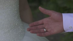 Just married young wedding couple holding hands - stock footage