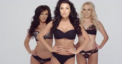 Three fashion models in black lingerie - stock footage