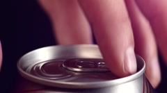 Hand opening can with spray, splash, on black, slow motion - stock footage