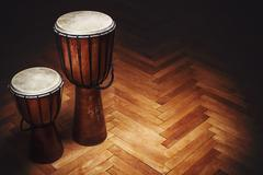 Two Djembes on Parquet - stock photo